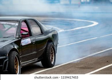 Car driver drifting Drag racing car burns rubber