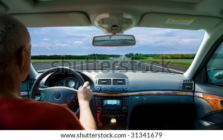 The car with the driver on highway