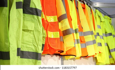 Car driver and road workers special clothing - new bright jackets with reflective stripes in showroom