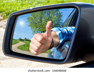Car driver with thumb up