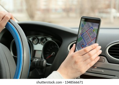 Car driver using mobile phone for navigation