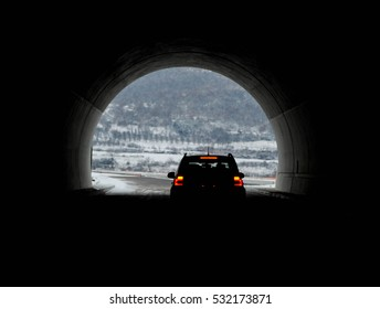 Car drives through the tunnel