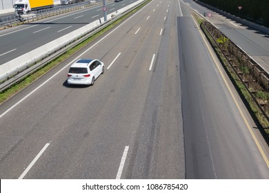 Car is driving constantly left on a three-lane highway