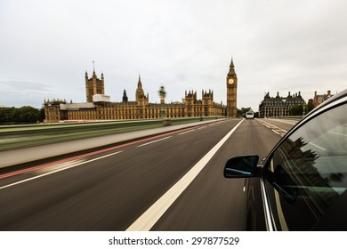 Car driving fast in city of London.
