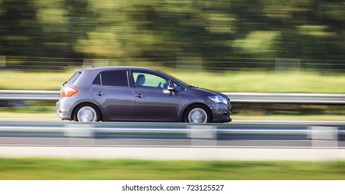 Car driving fast motion on highway side view