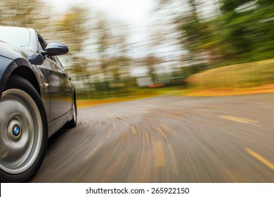 Car driving in forest road.
