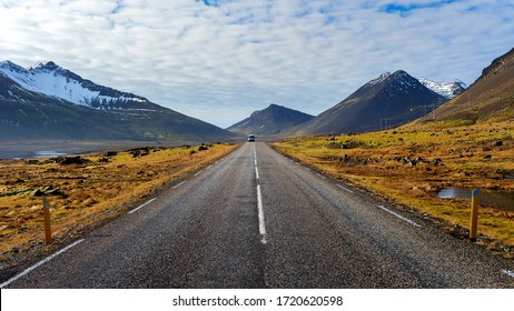 Car driving on beautiful road in Iceland.