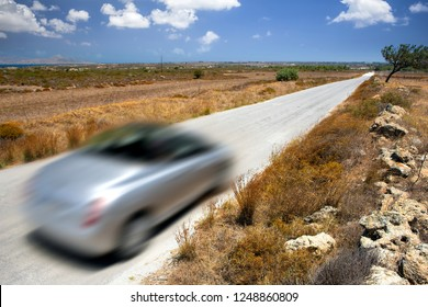 Car driving on a country road at sunny day, motion blur