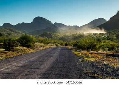 Car driving on the dirt road in mountains in Mexico