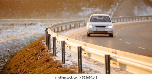 Car driving on empty road, Poland, Europe