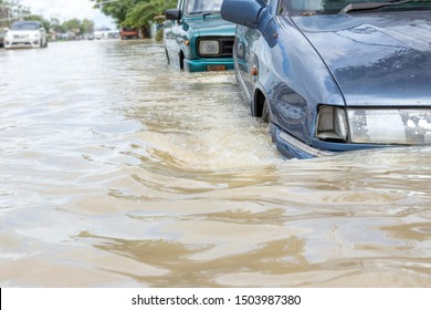 Car driving on a flooded road, The broken car is parked in a flooded road.