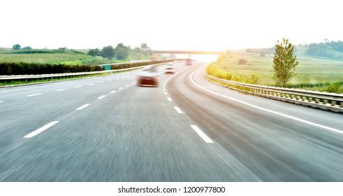 Car driving on freeway, motion blur