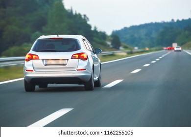 Car driving on the highway from Rijeka to Zagreb with Gorski Kotar forest in the background in Croatia.