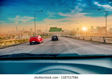 Car driving on highway road in the city