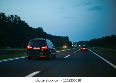 Car driving on the highway at sunset.