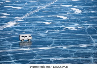 car driving on ice in lake baikal