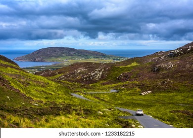 Car driving on a lonley road through Gap of Mamore, Inishowen, County Donegal, Ireland