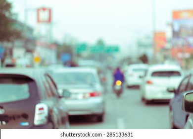 car driving on road with traffic jam in the city, abstract blurred background
