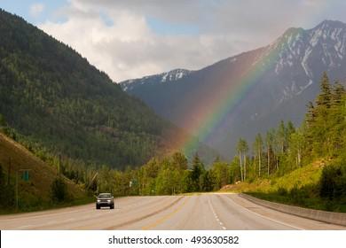 Car driving on Trans-Canada highway through Rockies in Alberta, Canada