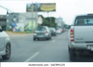 car driving on urban road, image blur background