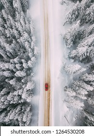 Car driving on winter road. seen from above. Aerial photography. Location: Rarau Mountains, Romania.