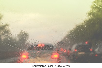 Car driving in a rain storm background.traffic jam