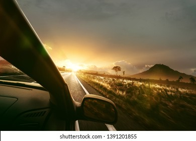 Car is driving in the sunset