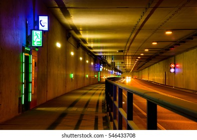 Car driving through a tunnel with speed limit 70 kmph. Emergency exit in a tunnel