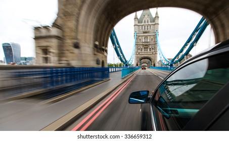 Car driving in to Tower bridge, London.