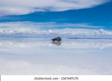 Car driving in the wet salt flats