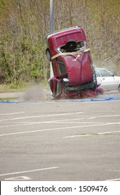 A car dropped from a height of 120 feet crashes into the pavement at 60 miles per hour in a safe driving demonstration.
