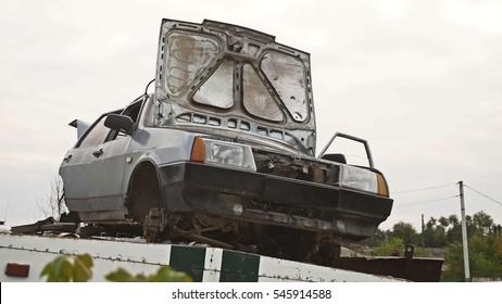 Car dump an old car with an open hood