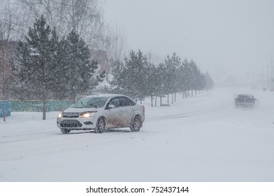 car during a snowfall on the road