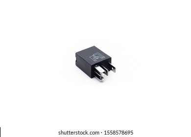 Car electric relay switch on isolated white background. Car electric spare part.
