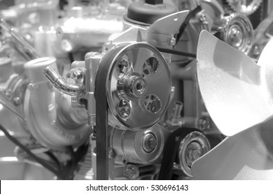 Car engine close up, focus on pulley