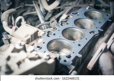 Car engine repair. cylinder head gasket replacement in workshop