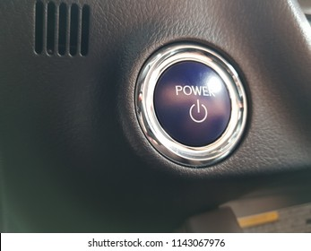 Car engine start stop button of a modern car. Close-up power button for starting a luxury modern hybrid car.
