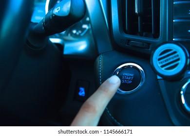 Car engine start stop button of a modern car.