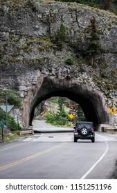 Car enters a tunnel San Juan Mountains Colorado USA