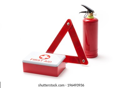 Car equipment - emergency triangle, extinguisher and first aid kit.
