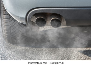 Car exhaust pipe coming out of the diesel exhaust. Concept: transport or health protection