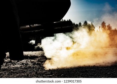 Car exhaust pipe, which comes out strongly of smoke in Finland.  The air looks really hard to breathe. Image includes a effect.