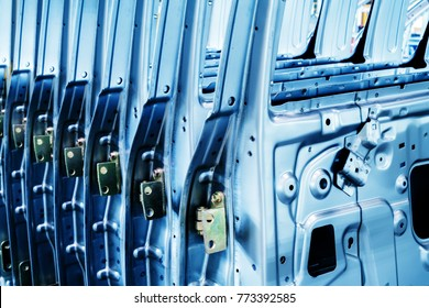 A car factory; neatly arranged exterior components of a car