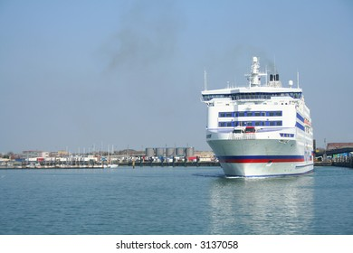A car ferry leaves Portsmouth harbour for France