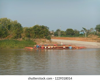 Car ferry on the banks of the Wood River. Brazil