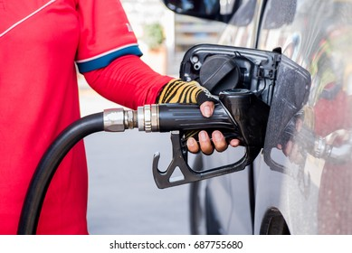 A car is filled with the fuel petrol stations.