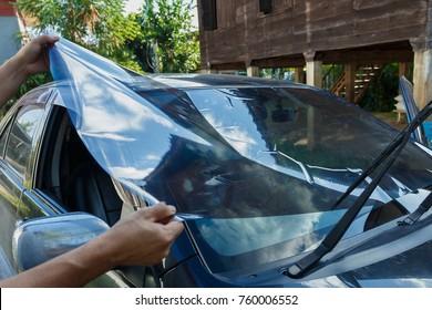 Car Films Installing windshield protection film blur.
