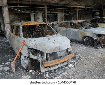 a car was  fire in showroom