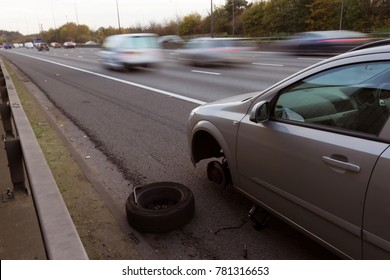 Car with flat tyre stopped on hard shoulder of motorway