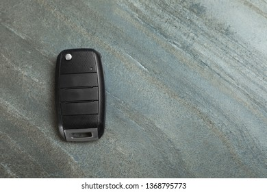 Car  flip key on grey background, top view with space for text